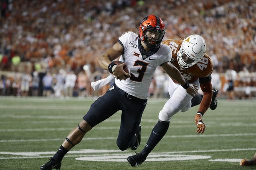 Ehlinger leads No. 12 Texas past Oklahoma State 36-30