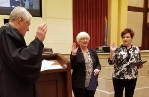 Two commissioners take oath of office